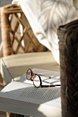 Glasses lying on book