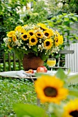 Bunch of flowers and fruit on garden table