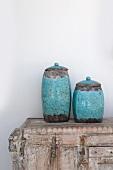 Two earthenware jugs on dresser