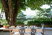 Breakfast on Mediterranean terrace and view of trees and landscape