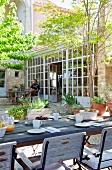 Breakfast in courtyard of Mediterranean country apartment building