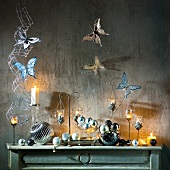 Turquoise Christmas decorations: butterflies, candles, baubles