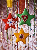 Fabric hearts and strings of beads as Christmas decorations