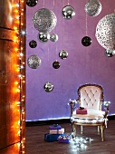 Upholstered chair with fairy lights, Christmas baubles and presents
