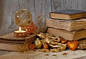Gold Christmas decorations and a stack of books