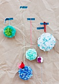 Pompoms made from plastic bags as wall decorations