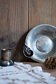 Antique Hammered Metal Dish with an Antique Metal Cup in Rustic Setting