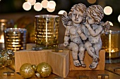 Pair of Christmas angels and gold, glass tea light holders
