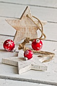 Red Christmas baubles and wooden stars