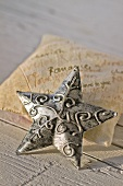 Decorative, metal star on scented sachet