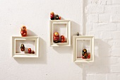Russian dolls in white picture frames as Christmas decorations