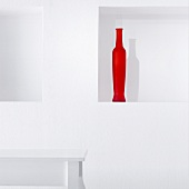 Red vase in wall niche