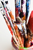 Used paint brushes in jars