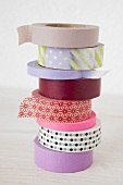 A stack of various rolls of masking tape