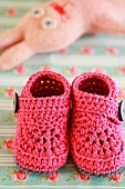 Pink, crocheted baby bootees