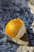 Opened eggshell with gilt inside surface