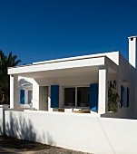 White Mediterranean house below a blue sky