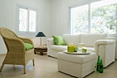 White upholstered suite and basket chair in corner of minimalist living room