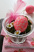Easter arrangement with Easter egg, moss and feather