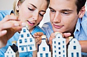 Couple looking at model houses