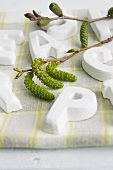 Table decoration with willow catkins & letters