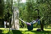 Relaxing in hammock in Mediterranean garden