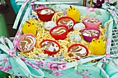 Desserts in colourful cases and Easter decorations in fabric-covered box