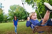 Boy on swing in garden