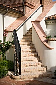 Brick staircase with wrought iron railing