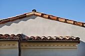 Detail roof line with red tile roof