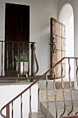 Wrought iron railing along stone staircase
