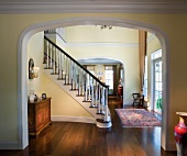 Archway and grand staircase in plantation house