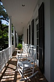 Wooden rocking chairs on front porch