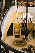 Chandelier hanging above staircase in elegant home
