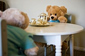 Children's stuffed animals having tea party