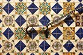 Hand rail against decorative tile