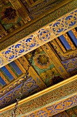 Detail ornately painted ceiling beams