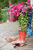 mud boots with flowers in country garden