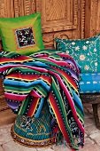 Brightly colored blanket and decorative pillows