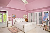 Interior of Pink bedroom with white bed