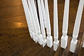 Detail white spindles of staircase railing