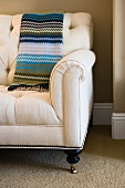 Striped blanket on love seat