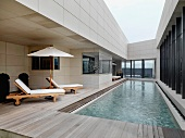 Wading pool and lounge chairs