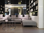 Modern sectional sofa in front of mirror