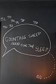 Counting sheep - tip for nodding off written on blackboard wall