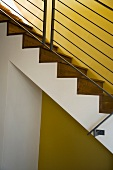 Detail of Modern Hardwood Stairwell and Yellow Wall