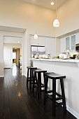 Three bar stool in a contemporary kitchen