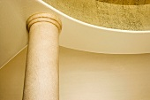 Architectural Detail of Ornate Gold Walls and Columns