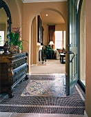 Mosaic tiled floor of home entry