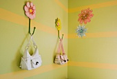 Girl's Purses Hanging on Bedroom Wall